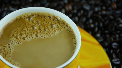 rotating a cup of coffee & coffee beans... Stock Video Footage