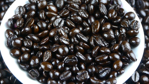 coffee grains in white cup saucer close up,top view Stock Video Footage