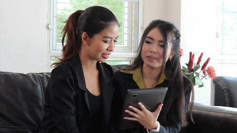Asian Female Office Workers Using Tablet Stock Video Footage