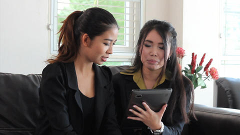 Asian Female Office Workers Using Tablet Footage