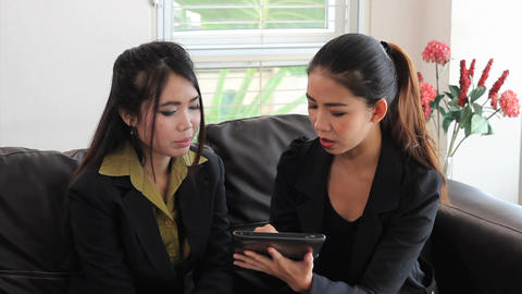 Asian Office Workers Discussing Work On Tablet Stock Video Footage