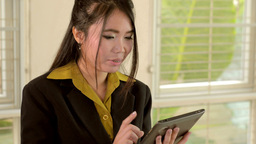 Young Asian Businesswoman Using a Tablet Computer Footage