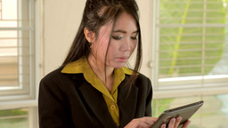 Young Asian Businesswoman Using a Tablet Computer Stock Video Footage