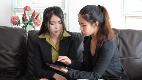 Asian Female Office Workers Discuss Project On Tablet stock footage
