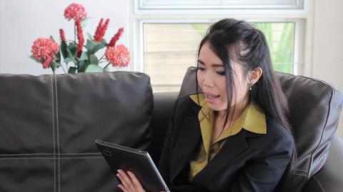 Cute Asian Office Worker Talking On Tablet Stock Video Footage
