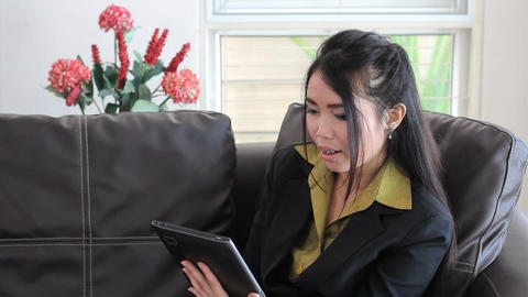 Cute Asian Office Worker Talking On Tablet Stock Video Footage
