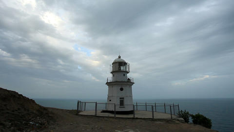 Lighthouse. The movement of clouds on the mountain... Stock Video Footage