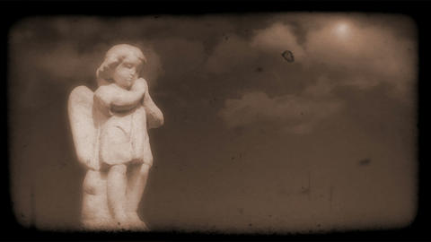 Vintage Film of Angel with Clouds moving in the background Animation