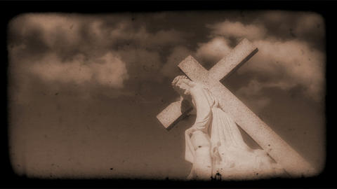 Vintage Film of crucifix with Clouds moving in the background Animation
