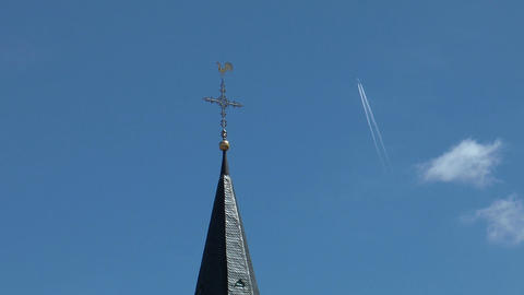Jet leaves contrails above weathercock Footage