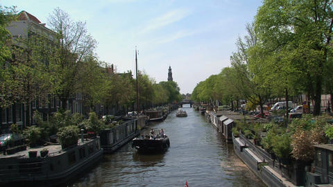 Boats in canal in Amsterdam Stock Video Footage
