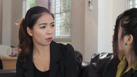 Asian Office Girl Listens To Coworker Stock Video Footage