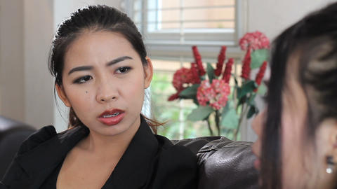 Two Asian Ladies Talking At Work Stock Video Footage