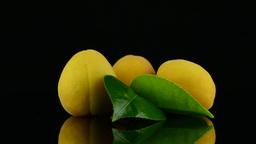 Three apricots Stock Video Footage