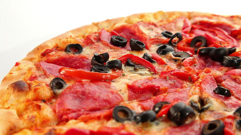 Delicious pizza, cheese, salami and olives, dolly Stock Video Footage