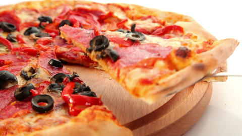 Tasty Italian pizza, cheese, salami and olives, do Stock Video Footage