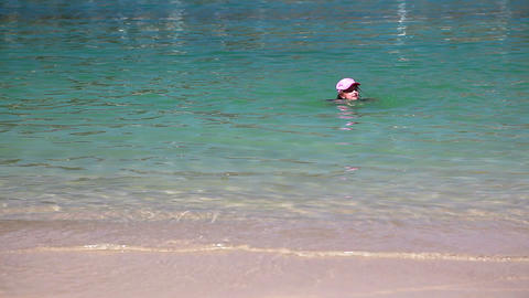 Young girl swimming in the sea, summer vacation ti Stock Video Footage