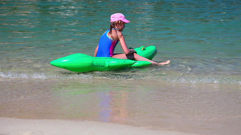 Girl playing at beach on crocodile in sea water Stock Video Footage