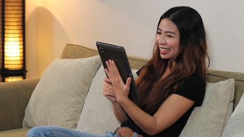 Asian Woman Talking To Friend On Tablet Stock Video Footage