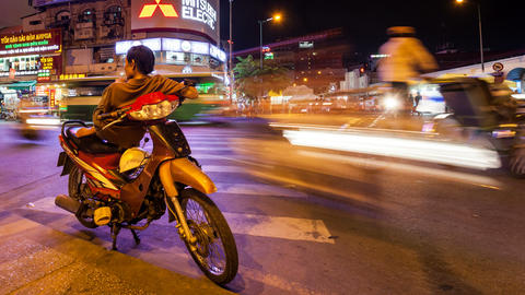 VIETNAMESE MOTO TAXI WAITING FOR CLIENTS - TIME LA Footage