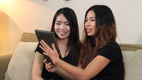 Asian Women Talk To Friends On PC Tablet Stock Video Footage