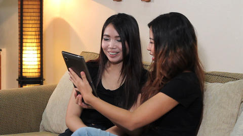Asian Women Talking On PC Tablet For First Time Stock Video Footage