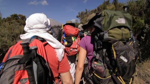 Trekkers headed down the trail towards Kilimanjaro Footage