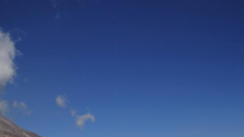 Blue sky pan to Kilimanjaro Stock Video Footage