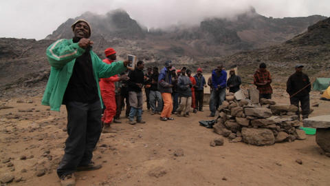 Porters dance at the base of the mountain Footage