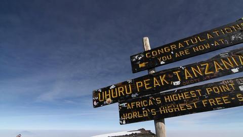 Pan summit sign on top of Kilimanjaro Stock Video Footage