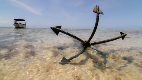 Close up of anchor at low tide with boat Footage