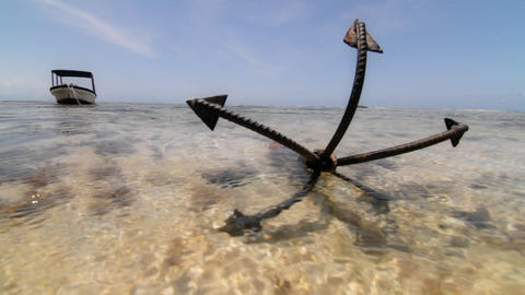 Close up of anchor at low tide with boat Stock Video Footage