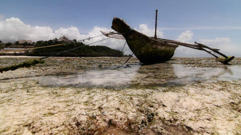 Skiff at low tide in the bay Stock Video Footage