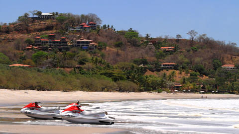 Beach shot with jet skis sitting on sand Stock Video Footage