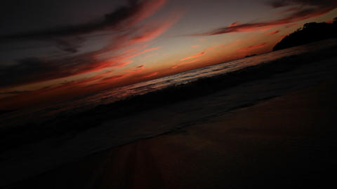 Sun setting with wave breaking and crashing Stock Video Footage