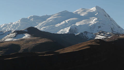 Static shot of snowy peak in late day sun Stock Video Footage