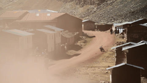 Truck drives fast through village Footage