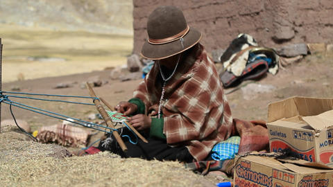 Pan to traditional women weaving Footage