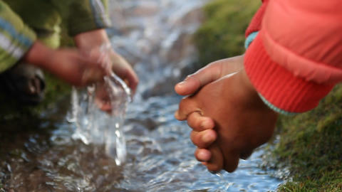 Close up of children's hands in brook Stock Video Footage