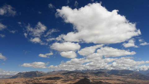 Static shot of clouds over valley Stock Video Footage