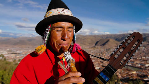 Traditional musician , Cusco in background Stock Video Footage