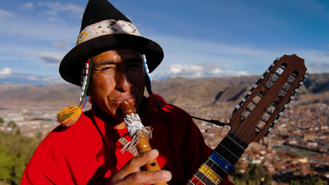 Traditional musician , Cusco in background Footage