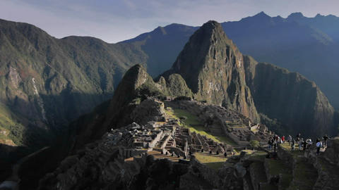 Tourist at Machu Picchu in morning sun Stock Video Footage