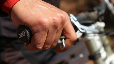 Close-up of biker gripping brakes Stock Video Footage