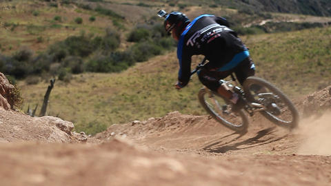 Pan across trail as bike goes down trail Stock Video Footage