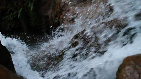 Looking down waterfall as water rushes over the edge Stock Video Footage
