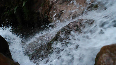 Looking down waterfall as water rushes over the edge Footage