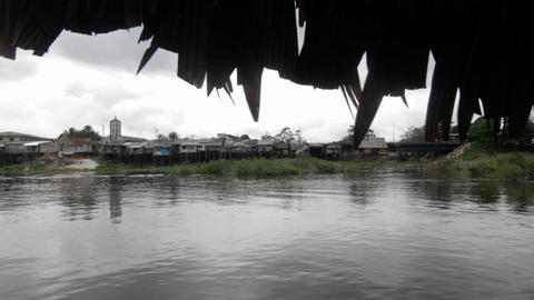 Village view from boat on the river Stock Video Footage