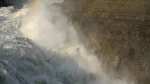 Closer shot of rainbow over waterfall Footage