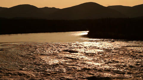 Flowing river shining in the setting sun Stock Video Footage